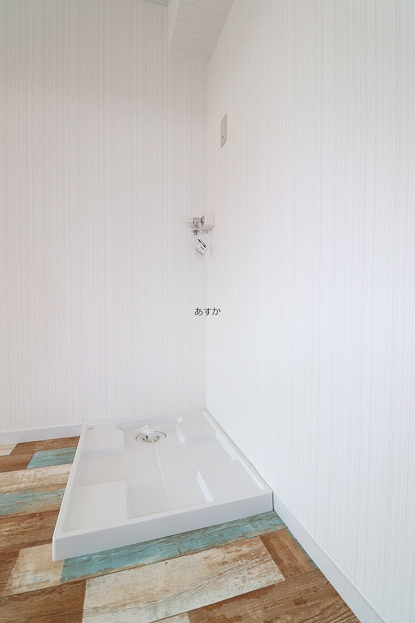 リビング入口の室内洗濯機置場