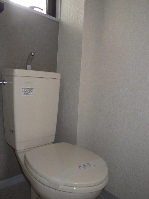 トイレもクロスでスッキリ